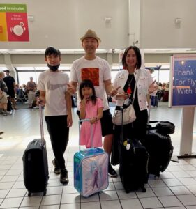 Family at the airport heading on Summer Vacation